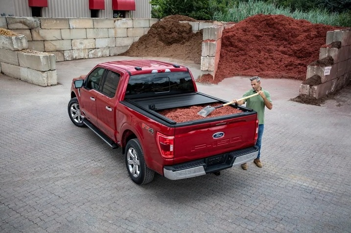 Tonneau cover on red Ford F150