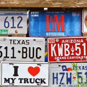 Various license plates on a wall