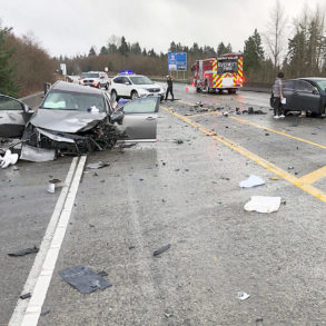 Vehicle collision on the highway at day