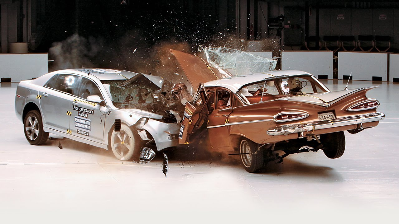 New and old car colliding with each other during a crash test
